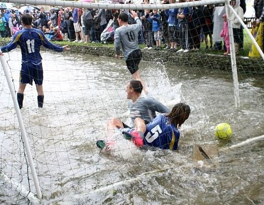 Everyone has a splashing time at the annual football in the river match at Bourton-on-the-Water.