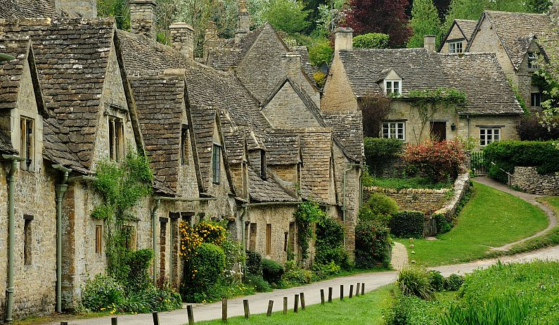 "The group of former weavers' cottages at Arlington Row, Bibury, helped it gain the accolade of ""the most beautiful village in England""."