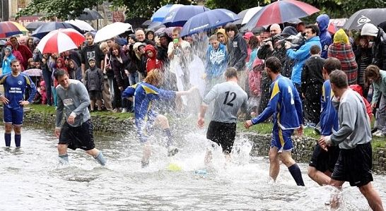 Bourton-on-the-Water's annual football in the river match has gained media attention around the world.