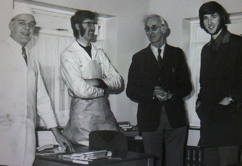 A different era: Harry Workman (second right) with his two sons Roger (second left) and Philip (right) with dairy manager Fred Jones (left) in the 1970s.