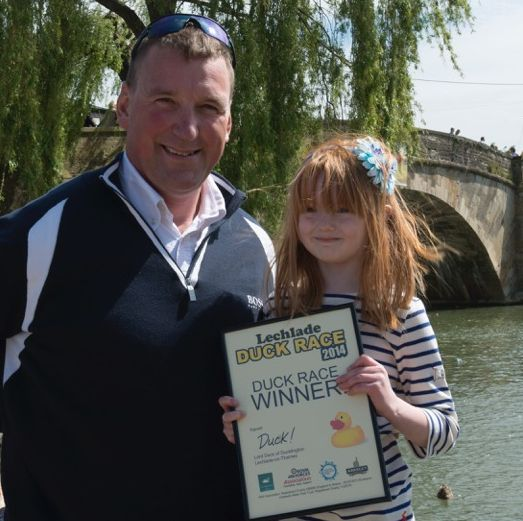 Olympic rowing champion Sir Matthew Pinsent with Trinity Bunn, owner of the winning duck at the 2014 Lechlade Duck Race. Picture Crown Copyright.