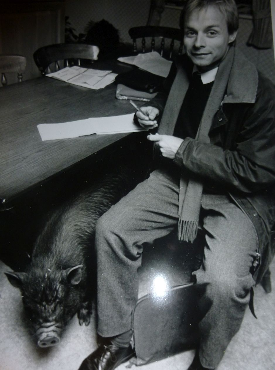 Cotswold reporter David Wood 'back in the day' trying to conduct an interview in the presence of a Vietnamese pot-bellied pig.