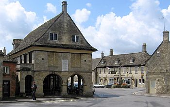 Minchinhampton's 17th Century Market House has arches barricaded to prevent the entry of cattle from surrounding commons.