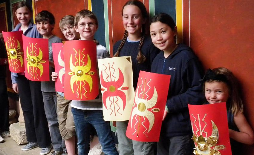 Young visitors to the museum with Roman shields.