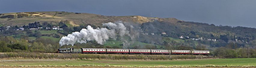 Cleeve Hill provides a stunning backdrop to a GWR locomotive. Picture by Andrew Hill.