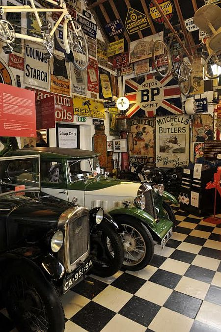 Some of the vintage vehicles and signs at the Cotswold Motoring Museum.