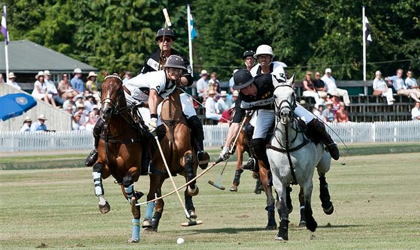 Match action from Cirencester Park Polo Club where the game has been played for 120 years.