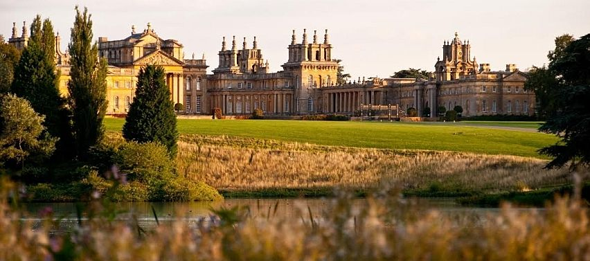 A sun-kissed view of Blenheim from the lakeside.