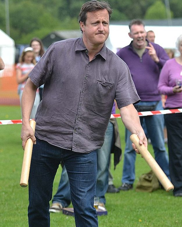 Former Prime Minister and local MP David Cameron tries his hand at Aunt Sally during a visit to the first Aunt Sally World Championships held at the Charlbury Beer Festival.