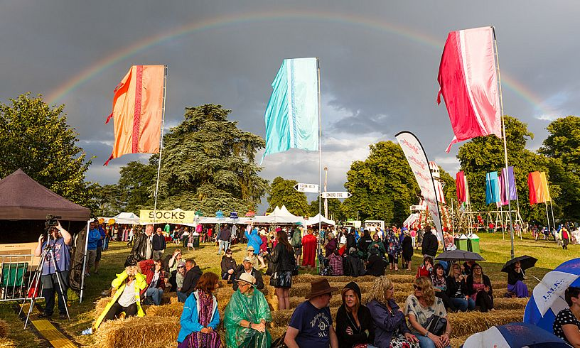 The rainbow of colours created by Cornbury fans is matched perfectly by the real thing at the 2014 festival.