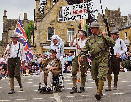Chipping Campden folk give a special tribute to mark the centenary of the outbreak of the First World War during the 2014 Scuttlebrook Wake. Picture © Julia Lindop