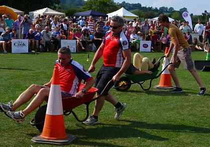 Wheelbarrow racing fun at the Winchcombe Country Show.