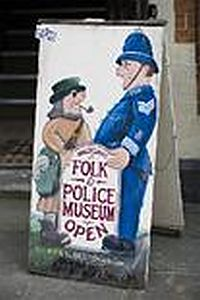 A board advertising Winchcombe Folk & Police Museum in the Town Hall.