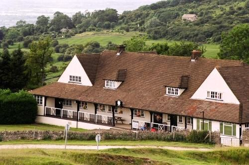 The golf clubhouse at Cleeve Hill, where the sport has been played since 1891.