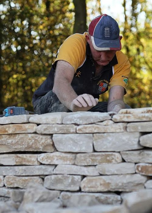 Traditional skills such as dry-stone walling help to preserve the special characteristics of the Cotswolds landscape.