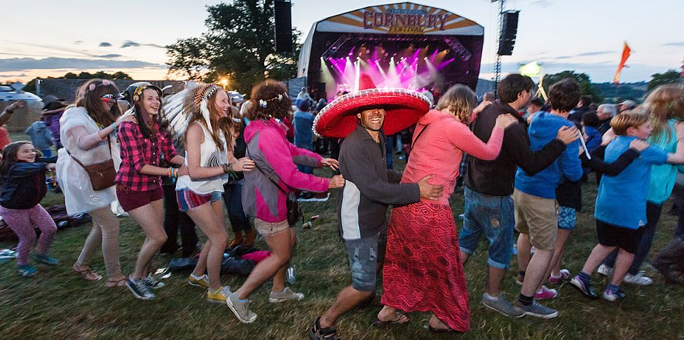 Music festivals are meant to be enjoyed, and this great picture perfectly sums up how most festival-goers feel about the Cornbury Music Festival, held at the Great Tew Estate in the Oxfordshire Cotswolds in early July. We especially love the young girl on the left who's desperate to join in the conga line fun!