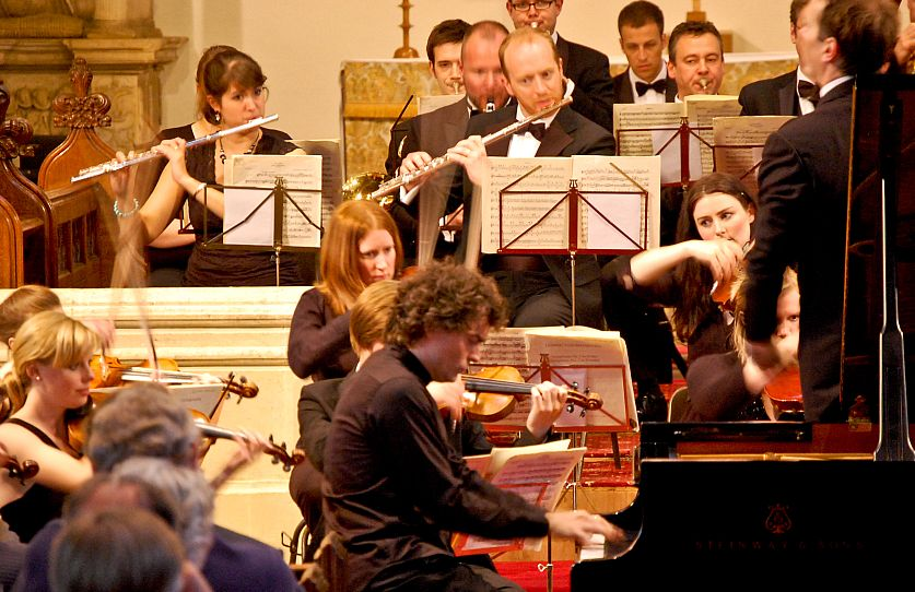 Classical musicians entertain a packed St James's Church at a Chipping Campden Music Festival concert, with festival president Paul Lewis at the piano.
