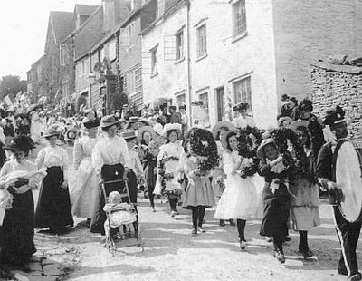 The 1909 Ascension Day parade in Bisley prior to the well dressing.
