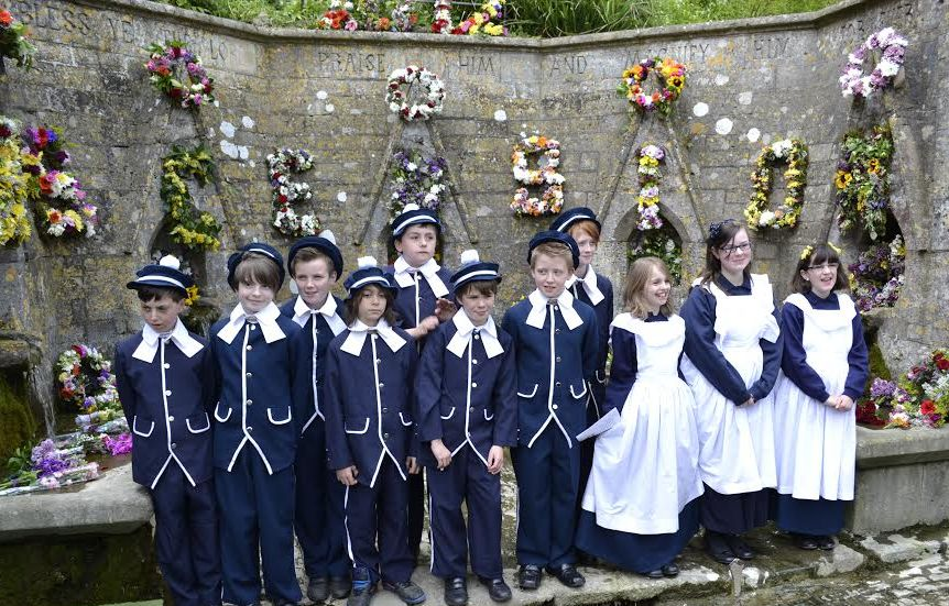 Children from Bisley Blue Coat School dressed in Victorian uniform for the well dressing ceremony, which takes place each year on Ascension Day.