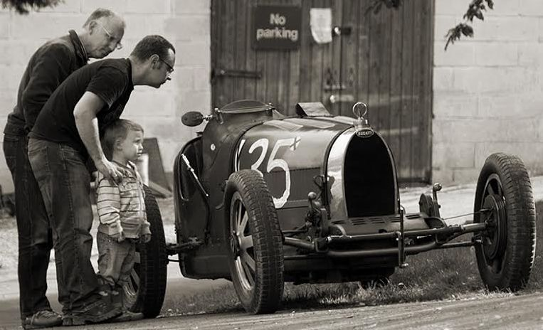 The classic cars on view at Prescott attract the admiration of all generations of motor racing fans.