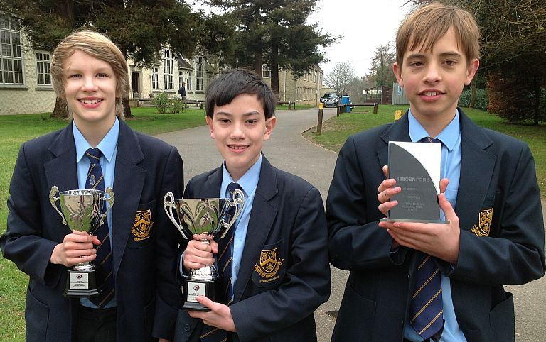 Team Zoom: Noah Booker, left, Chris Bridges, centre, and Olly Fisher with their trophies.