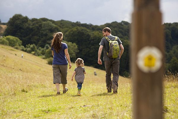 A family walking on Selsey Common on the Cotswold Way. Picture courtesy Costwolds Conservation Board.