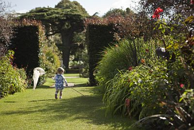 A young visitor enjoying the delights of Hidcote Manor Garden.