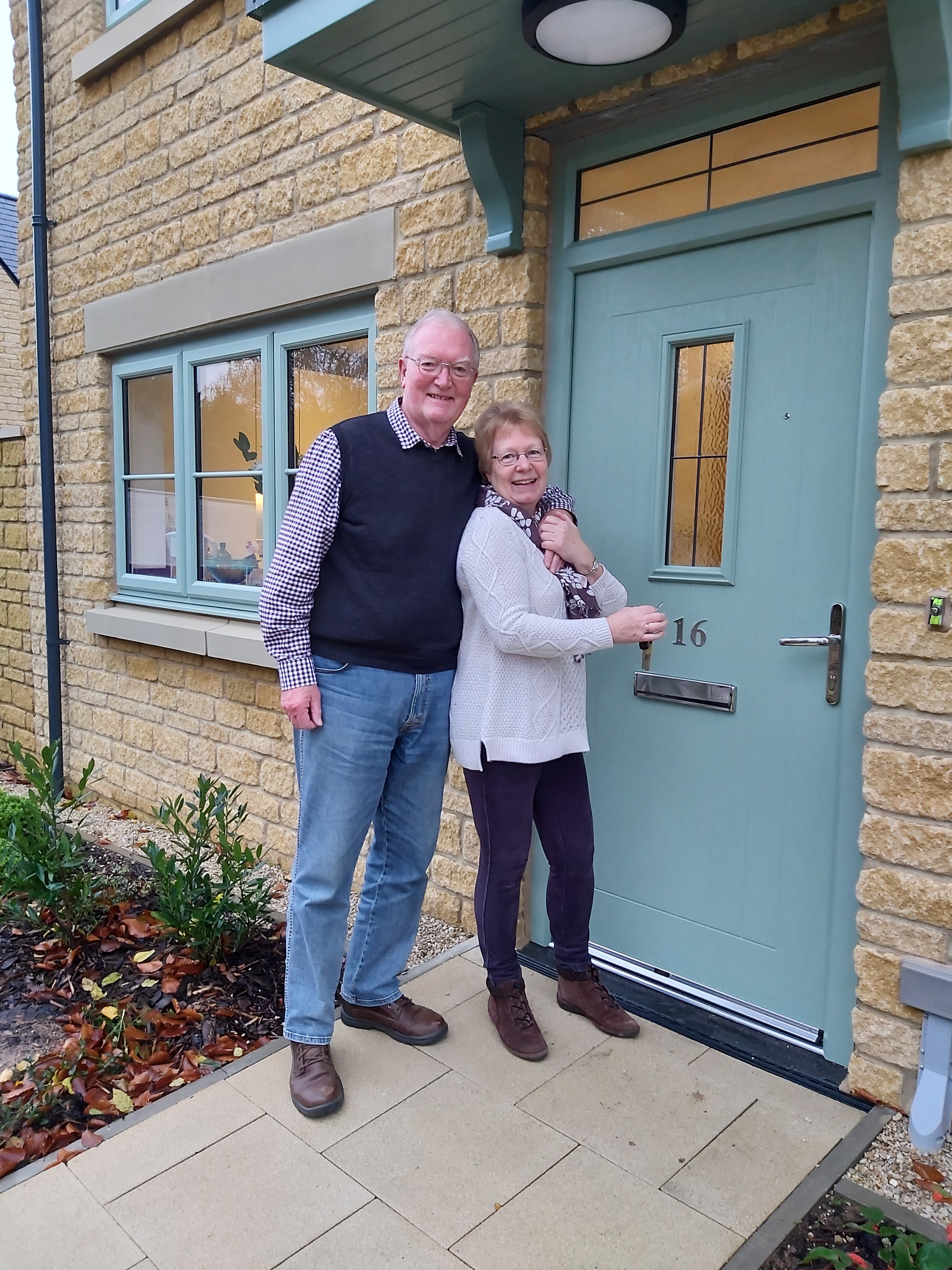 Jim Collinson and Eleanor French outside their new home in Milton-under-Wychwood.