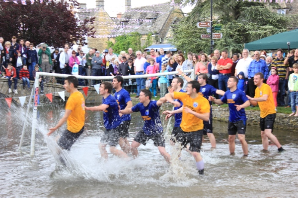 The River Windrush at Bourton-on-the-Water is the venue for the annual football in the river match on Monday, August 29.