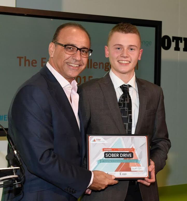 Callum Coles collecting the team first prize certificate from Theo Paphitis.