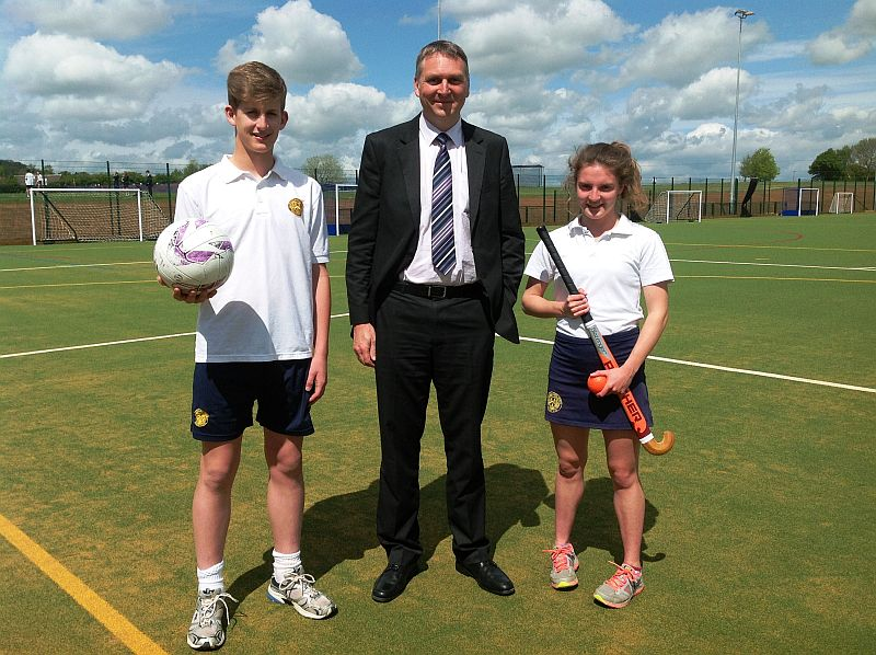 Chipping Campden School principal John Sanderson with Year 10 pupils Harley Rapp and Hannah Pritchard on the new all-weather pitch.