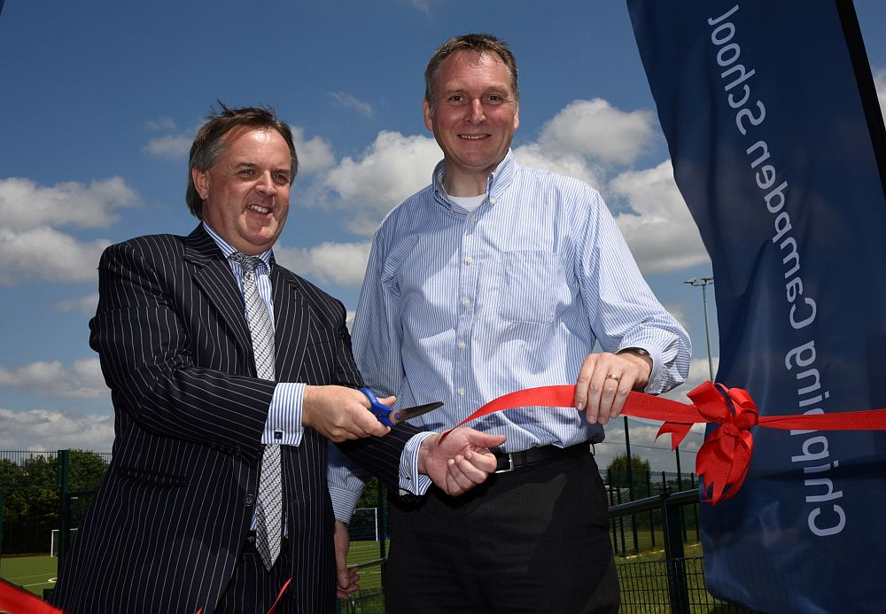 Councillor Lynden Stowe, left, officially opens the new artificial sports pitches, watched by Chipping Campden School principal John Sanderson.