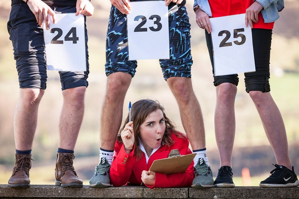 Redcoat Rachel Benson judging the knobbly knees competition. Picture credit: Peter Boyd