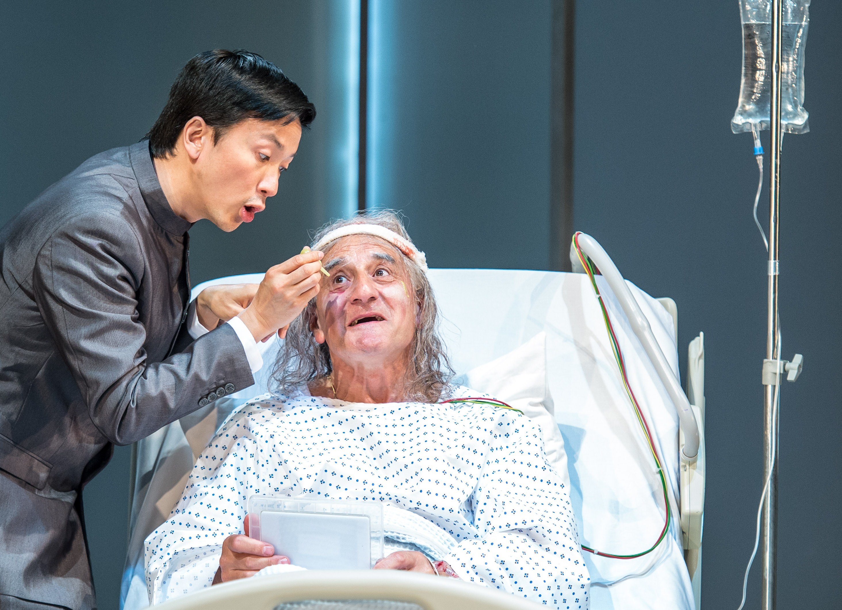 The invalid - Volpone (Henry Goodman) attended by Mosca (Orion Lee). Photo by Manuel Harlan.