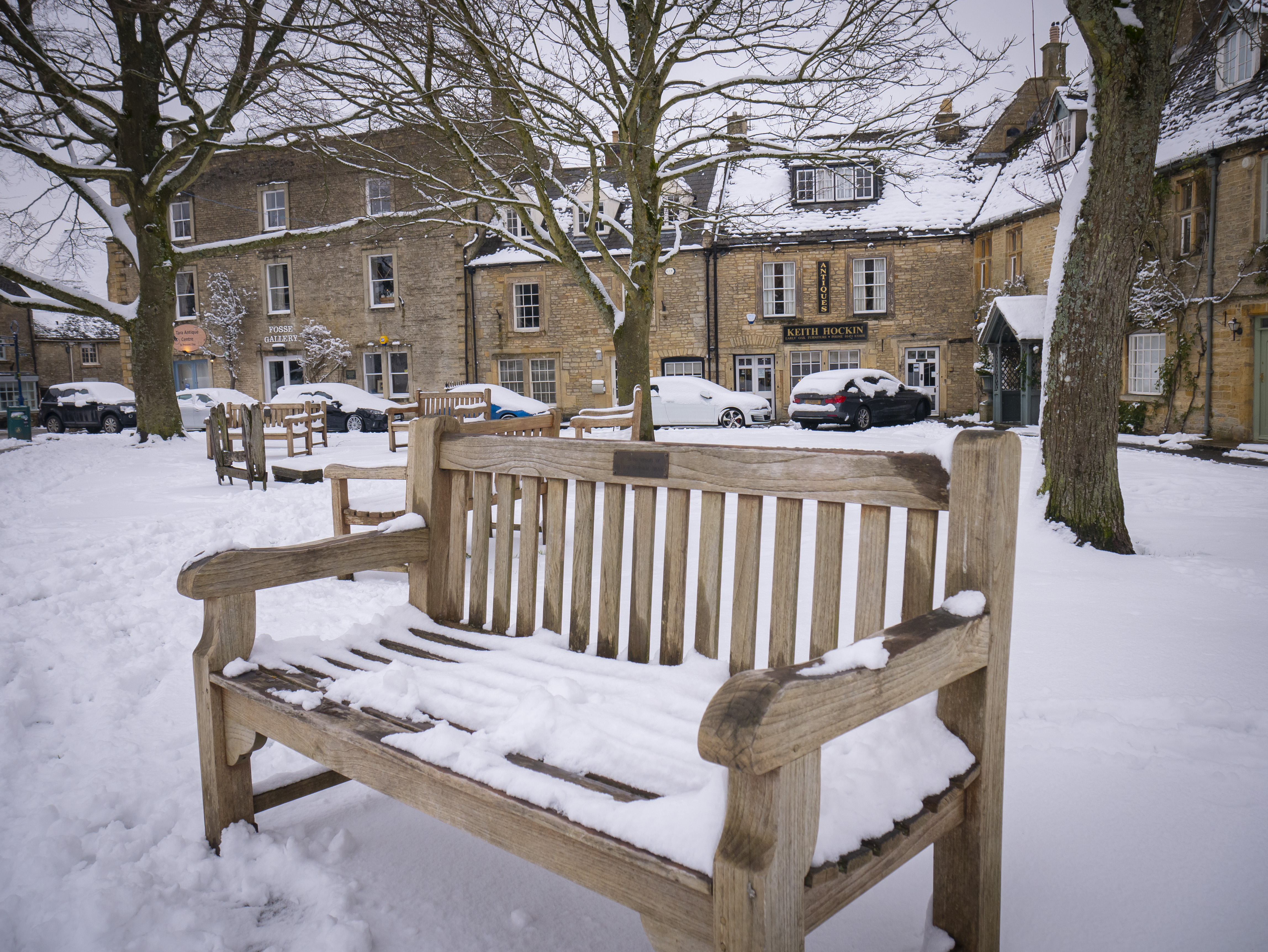 These snow-covered benches in Stow must have some stories to tell...