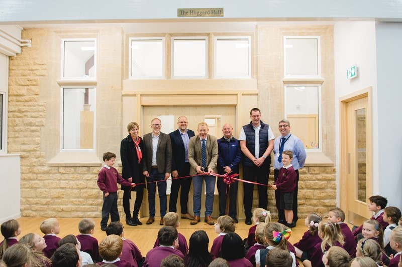 Pictured left to right are: Joyce Clifford - Quattro Design Architects, Gloucestershire County Cllr Paul Hodgkinson, Chair of Governors Giles Hyland, Adam Henson, Speller Metcalfe site manager Mark Taylor, Nigel Francis, senior quantity surveyor for Speller Metcalfe, and headteacher John Jones.