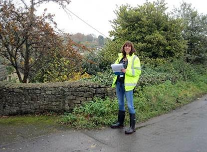Asset surveyor Jasmine McWilliams, CDC property and estates department, at work in Avening on 15 November.