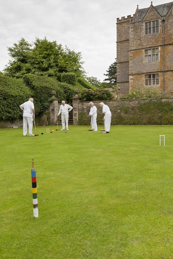 Volunteers playing croquet on the lawn of Chastleton House. Picture © National Trust.