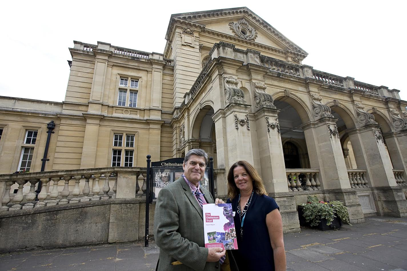 Peter Harkness, chairman of Cheltenham Trust, and Julie Finch, CEO, presenting the Cheltenham Trust Impact Report at Cheltenham Town Hall.
