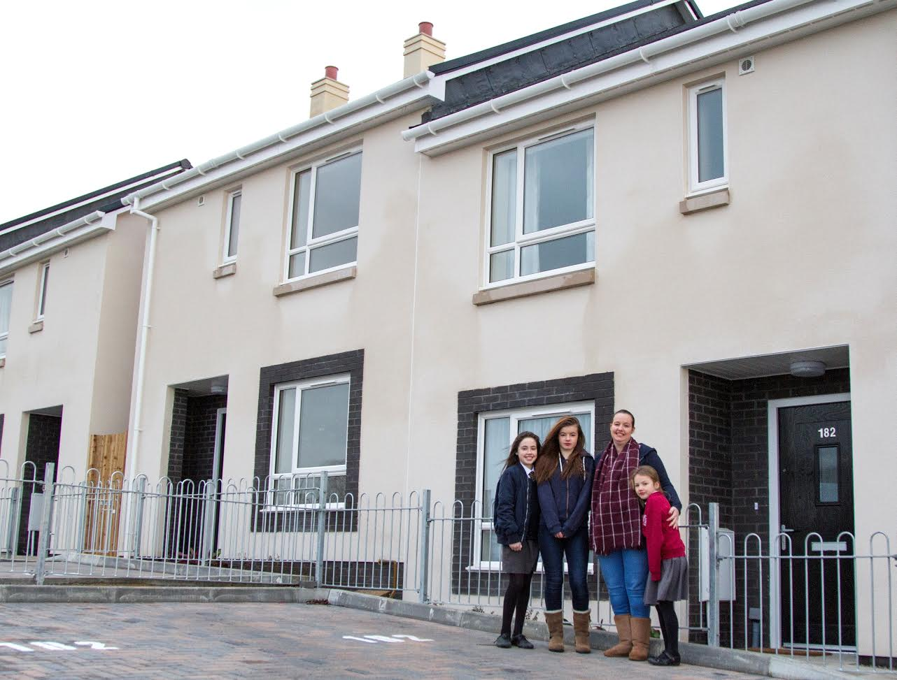 Pictured left to right: Tiani, Phoebe, Coraley & Macie Driver outside their new council home in Bisley Old Road, Stroud. Photo by Theseus Lythgoe.