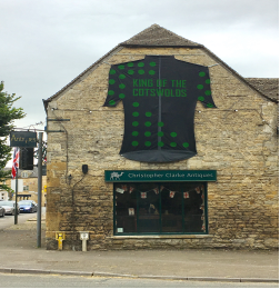 Christopher Clarke Antiques shop in Stow-on-the-Wold displaying the 'King of the Cotswolds' jersey.