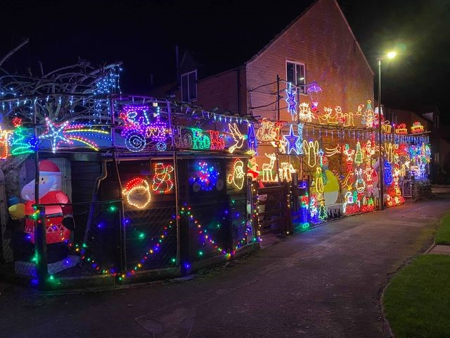 The Wearing family's Christmas light display near Cirencester is shining brightly this year in memory of a much loved wife, mother and grandmother, and is raising much needed funds for the Gloucestershire hospice who cared for her.